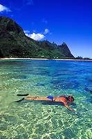 Woman snorkeling at Makua or Tunnels beach, Haena, North shore  of Kauai