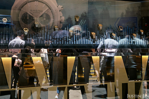 People pass by a watch shop in Hong Kong's Central financial district.