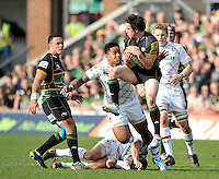 Northampton, England. Jamie Elliott of Northampton Saints wins a high ball during the Northampton Saints and Leicester Tigers  during the Aviva Premiership match at Franklin's Gardens, Northampton, England on March 29, 2014