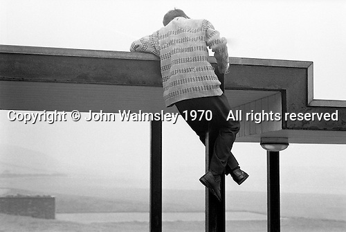 Climbing onto the school roof, Whitworth Comprehensive School, Whitworth, Lancashire.  1970.