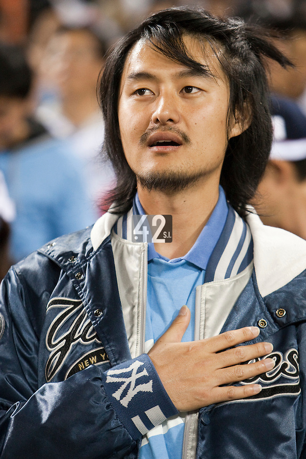 17 March 2009: A fan of Korea stands during the national anthem prior to the 2009 World Baseball Classic Pool 1 game 4 at Petco Park in San Diego, California, USA. Korea wins 4-1 over Japan.