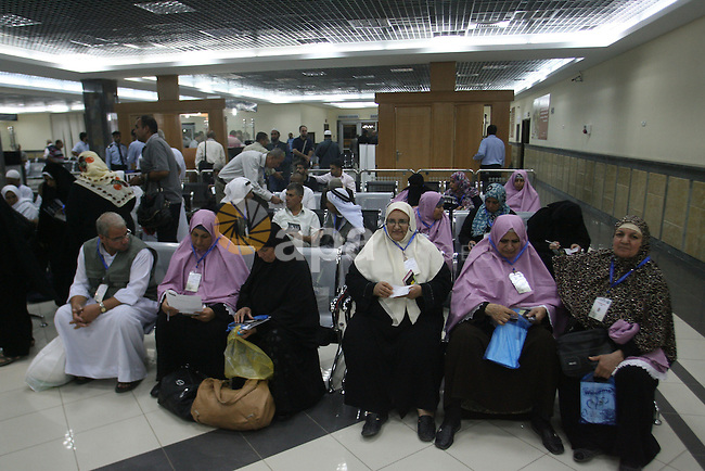 Palestinian pilgrims wait at a hall after they cross the Rafah border crossing into Gaza Strip, in the southern Gaza strip town of Rafah on Oct. 09, 2012. Hundreds of Palestinian pilgrims will cross into Gaza Strip on their way from Saudi Arabia after performing the annual Muslim Hajj pilgrimage. Photo by Eyad Al Baba