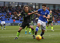 Oldham Athletic's Rob Hunt (right) shields the ball from Bristol Rovers' Stuart Sinclair (left) during the Sky Bet League 1 match between Oldham Athletic and Bristol Rovers at Boundary Park, Oldham, England on 30 December 2017. Photo by Juel Miah / PRiME Media Images.