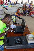 KENYA, Marsabit, village Laisamis, market hall, electronic registration for elections / KENIA, Markthalle, elektronische Registrierung fuer Wahlen