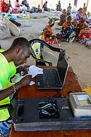 KENYA, Marsabit, village Laisamis, market hall, electronic registration for elections / KENIA, Markthalle, elektronische Registrierung fuer Wahlen