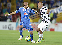 BOGOTÁ -COLOMBIA, 02-08-2014. Juan Esteban Ortiz (Izq.) jugador de Millonarios disputa el balón con Edwin Movil Cabrera (Der.) jugador de Boyacá Chicó FC durante partido por la fecha 3 de la Liga Postobón II 2014 jugado en el estadio Nemesio Camacho el Campín de la ciudad de Bogotá./ Juan Esteban Ortiz (L) player of Millonarios fights for the ball with Edwin Movil Cabrera (R) player of Boyaca Chico FC during the match for the third date of the Postobon League II 2014 played at Nemesio Camacho El Campin stadium in Bogotá city. Photo: VizzorImage/ Gabriel Aponte / Staff