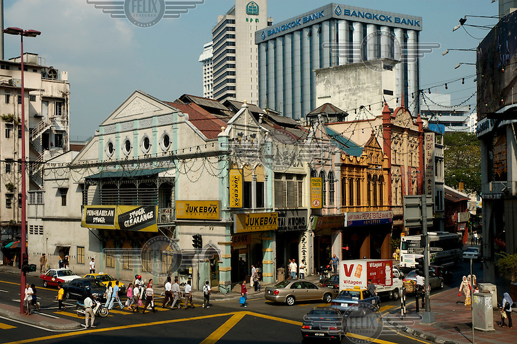 Chinatown view showing a mix between traditional architecture of shophouses and modern highrise office buildings behind.