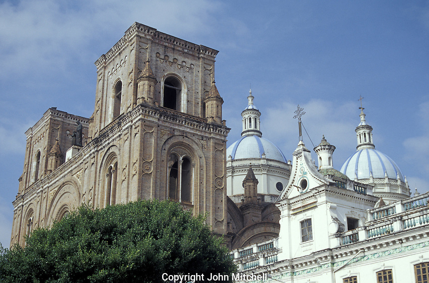 Facade and blue and white domes of the new cathedral or Catedral de la Inmaculada Concepcion in Cuenca, Ecuador