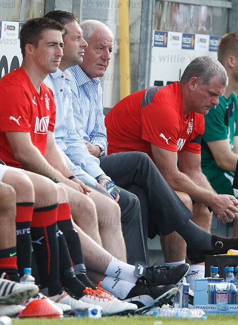 Craig Mather and Walter Smith watching from the bench