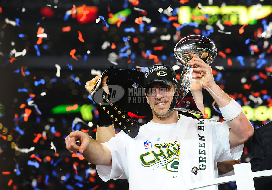 Feb 6, 2011; Arlington, TX, USA; Green Bay Packers quarterback Aaron Rodgers celebrates with the Vince Lombardi trophy after the Packers defeated the Pittsburgh Steelers in Super Bowl XLV at Cowboys Stadium.  Mandatory Credit: Mark J. Rebilas-