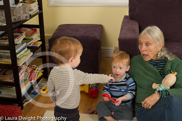 20 month old toddler fraternal twin boys with grandmother, one child pointing, grandmother talking to them;child care grandmother takes care of grandchildren twice a week