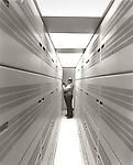 Scan of vintage black & white print. C-Tec 1987 telephone circuit board switching room. Negative file# 87-276-B#5