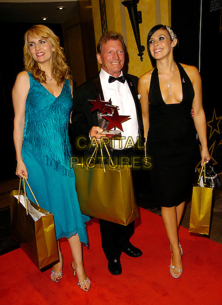 DEBRA STEPHENSON, JOHNNY BRIGGS & KYM MARSH.TV Quick & TV Choice Awards afterparty, Dorchester Hotel, London, UK..Septembber 4th, 2006.Ref: CAN.full length black suit award trophy tuxedo goody bag turquoise dress halterneck plunging neckline.www.capitalpictures.com.sales@capitalpictures.com.©Can Nguyen/Capital Pictures