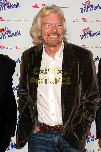 "SIR RICHARD BRANSON .BritWeek 2010 Charity Event: ""Save The Children and Virgin Unite"" held at the Beverly Wilshire Hotel, Beverly Hills, California, USA, 22nd April 2010..half length grey gray brown velvet jacket blazer hands in pockets belt  facial hair beard goatee white shirt smiling .CAP/ADM/BP.©Byron Purvis/AdMedia/Capital Pictures."