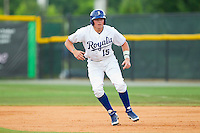 Chad Johnson (15) of the Burlington Royals takes his lead off of first base against the Princeton Rays at Burlington Athletic Park on July 5, 2013 in Burlington, North Carolina.  The Royals defeated the Rays 5-1 in game one of a doubleheader.  (Brian Westerholt/Four Seam Images)