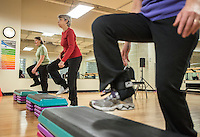 STAFF PHOTO ANTHONY REYES &bull; @NWATONYR<br /> Fink Holloway, left, leads Arlene Schuenemann, of Fayetteville, and Jean Greene, of Springdale, in the Strong Bodies program Tuesday, Dec. 23, 2014 at the Jones Center in Springdale. The program promotes fitness for seniors. The Jones Center will soon start a Silver Sneakers program, where seniors can qualify through their insurance for a free fitness membership.