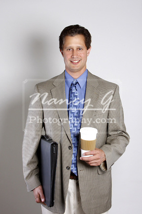 A business man with a cup of coffee and a portfolio