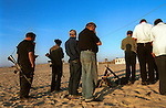 Visiting settlers, who arrived from the Israeli settlement of Elkana, West Bank, conduct an evening prayer on the beach at the Israeli outpost of Shirat Hayam, in the settlement bloc of Gush Katif, Gaza Strip.