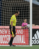 Foxborough, Massachusetts - October 15, 2017: In a Major League Soccer (MLS) match, New England Revolution (blue/white) defeated New York City FC (light blue/blue), 2-1, at Gillette Stadium.<br /> Assistant referee Claudiu Badea checks the net.