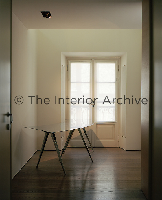 The elegantly minimal entrance hall of Antonio Citterio's apartment in Milan