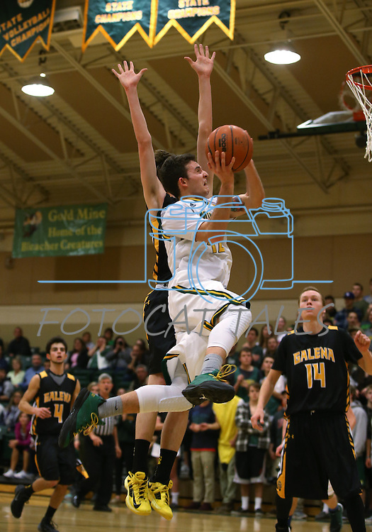 Manogue's Remy Dillard shoots over Galena defenders at Manogue High School in Reno, Nev., on Tuesday, Feb. 11, 2014. Manogue won 66-59.<br /> Photo by Cathleen Allison