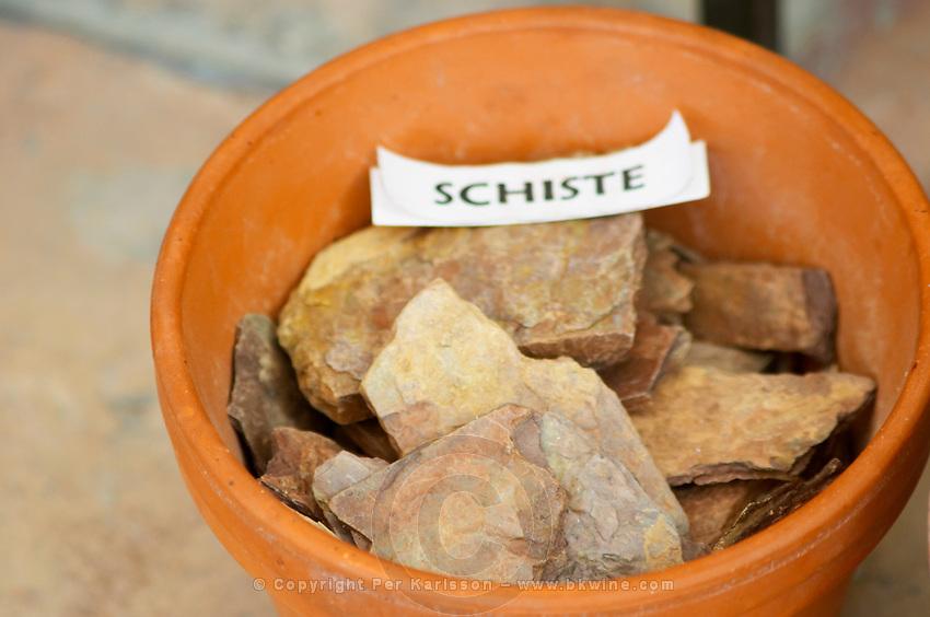 Plant pot with soil sample to illustrate different soil types, part of a series: schist schiste Chateau Villerambert-Julien near Caunes-Minervois. Minervois. Languedoc. Terroir soil. France. Europe. Schist slate soil.