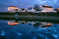 Houses along new Harbor are reflected in the waters of Block Island.