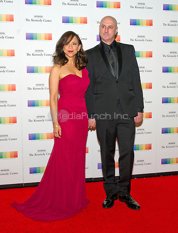 Rosie Perez and guest arrive for the formal Artist's Dinner honoring the recipients of the 38th Annual Kennedy Center Honors hosted by United States Secretary of State John F. Kerry at the U.S. Department of State in Washington, D.C. on Saturday, December 5, 2015. The 2015 honorees are: singer-songwriter Carole King, filmmaker George Lucas, actress and singer Rita Moreno, conductor Seiji Ozawa, and actress and Broadway star Cicely Tyson.<br /> Credit: Ron Sachs / Pool via CNP/MediaPunch