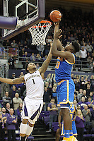 JAN 1, 2016:  UCLA's #23 Tony Parker drives to the basket against Washington.  Washington defeated #25 ranked UCLA 96-93 in double overtime at Alaska Airlines Arena in Seattle, WA.