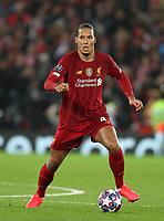 11th March 2020; Anfield, Liverpool, Merseyside, England; UEFA Champions League, Liverpool versus Atletico Madrid; Virgil van Dijk of Liverpool brings the ball forward