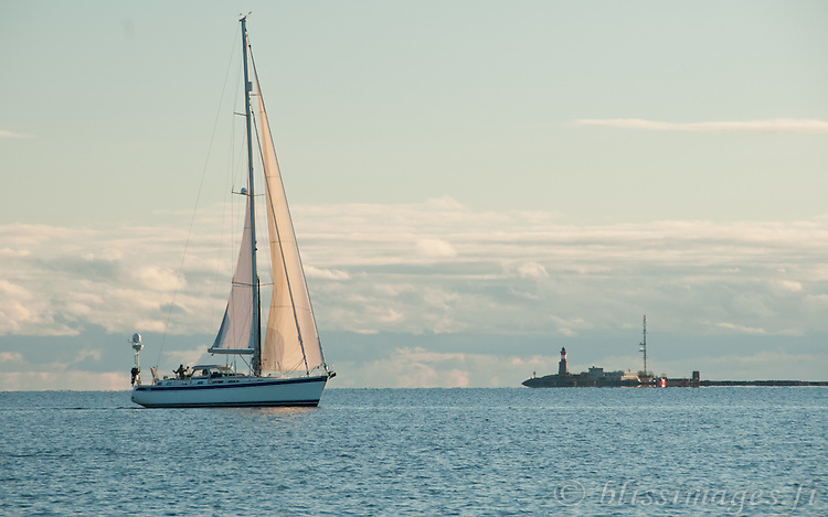A quiet evening sail near Harmaja lighthouse, off Helsinki, Finland.