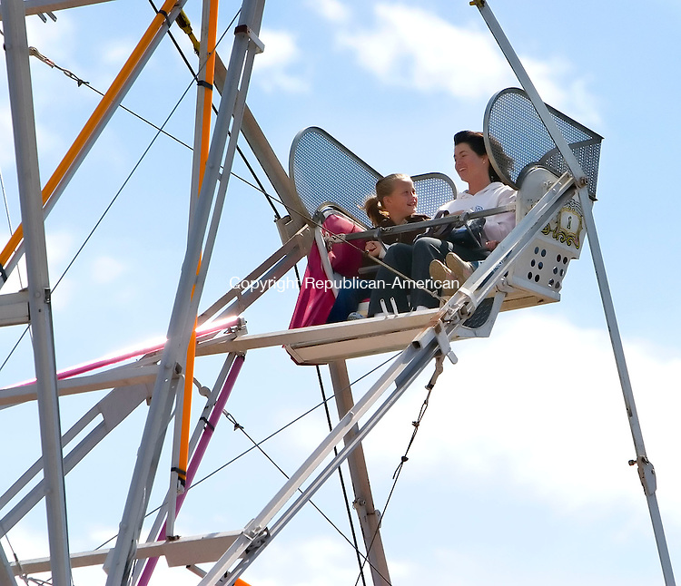 TORRINGTON, CT- 15 SEPT 2007- 091507JT03- <br /> From left, Cara McCarthy, 9, rides with her mother Chris and sister Julia, 4, on a Ferris wheel at Saturday's carnival in Fuessenich Park in Torrington.<br /> Josalee Thrift / Republican-American
