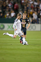 CARSON, CA – April 2, 2011: LA Galaxy midfielder David Beckham (23) passes the ball past Philadelphia Union midfielder Brian Carroll (7) during the match between LA Galaxy and Philadelphia Union at the Home Depot Center, March 26, 2011 in Carson, California. Final score LA Galaxy 1, Philadelphia Union 0.