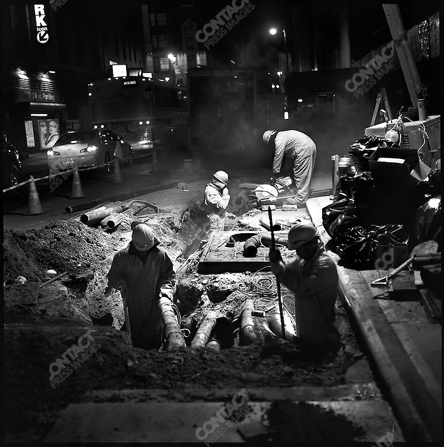 Workers on the night shift repaired the road on 35th street, Manhattan. New York City, New York, November 19, 2008