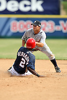 October 5, 2009:  Second Baseman Chris Sedon of the Detroit Tigers organization turns a double play over Rogearvin Bernadina during an Instructional League game at Space Coast Stadium in Viera, FL.  Sedon was selected in the 10th round of the 2009 MLB Draft.  Photo by:  Mike Janes/Four Seam Images