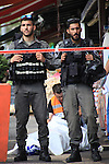 Israeli police secure the area as they stand next to the body of a dead Palestinian assailant at the spot where he stabbed two Israeli Jews before was shot dead outside Jerusalem's Old City October 10, 2015. Israeli forces shot dead two Palestinian assailants in East Jerusalem on Saturday, one of whom had stabbed two Israelis, police said, in a wave of violence that has raised concerns about a new Palestinian uprising. Police said two ultra-Orthodox Jewish men were wounded in the attack near Jerusalem's walled Old City. Earlier, paramilitary police shot dead a militant who had opened fire at them during late-night clashes at the Palestinian refugee camp Shuafat, police said. Photo by Mahfouz Abu Turk