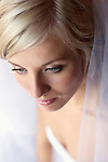 Bride wearing veil, close up