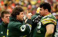 Assistant Coach Nolan Cromwell checks Frank Winters for a possible concussion during the December 22, 1996 game in which the Packers emerged victorious 38-10.