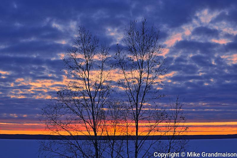 SUnset on Waskasiu Lake in winter<br /> Prince Albert National Park<br /> Saskatchewan<br /> Canada