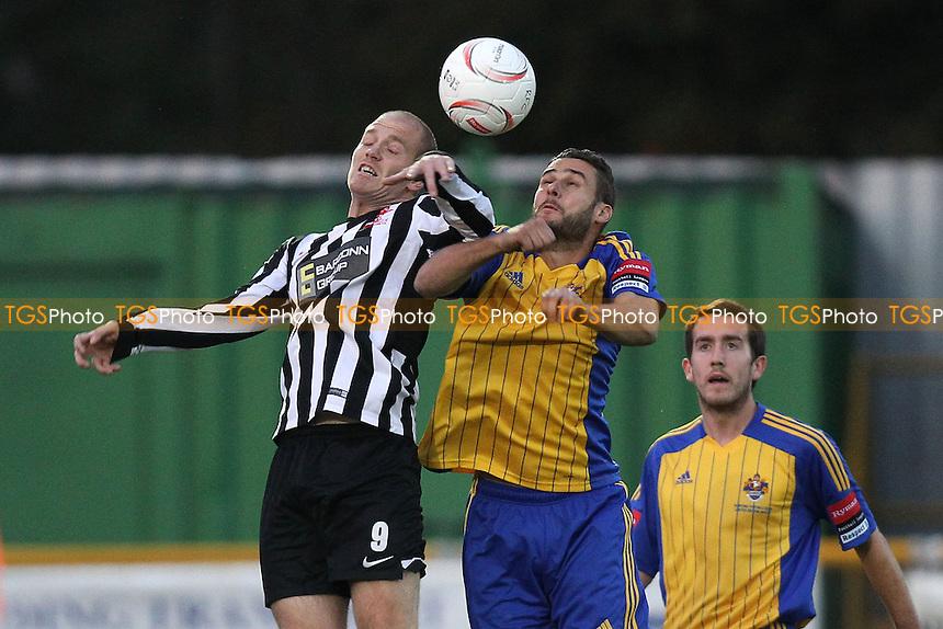 Paul Clayton of Romford rises with Luke Tuttle of Dereham - Romford vs Dereham Town - Ryman League Divison One North Football at Ship Lane, Thurrock FC, Purfleet, Essex - 20/08/14 - MANDATORY CREDIT: Gavin Ellis/TGSPHOTO - Self billing applies where appropriate - contact@tgsphoto.co.uk - NO UNPAID USE