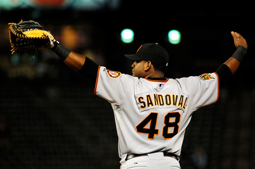 02 September 2008: San Francisco Giants 1st baseman Pablo Sandoval motions to the right fielder to move closer during a game against the Colorado Rockies. The Rockies defeated the Giants 6-5 at Coors Field in Denver, Colorado.