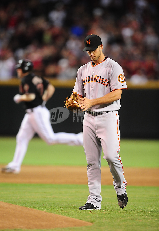 Jul. 24, 2010; Phoenix, AZ, USA; San Francisco Giants pitcher Madison Bumgarner reacts after giving up a home run to Arizona Diamondbacks batter Mark Reynolds in the sixth inning at Chase Field. Mandatory Credit: Mark J. Rebilas-