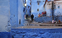 Stepped street and houses painted blue in the medina or old town of Chefchaouen in the Rif mountains of North West Morocco. Chefchaouen was founded in 1471 by Moulay Ali Ben Moussa Ben Rashid El Alami to house the muslims expelled from Andalusia. It is famous for its blue painted houses, originated by the Jewish community, and is listed by UNESCO under the Intangible Cultural Heritage of Humanity. Picture by Manuel Cohen