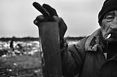 Katarzynowo, Northern Poland, December 2005<br /> The faces of Polish poverty<br /> Mikolaj Kozlowski, unemployed, age 53, at the waste heap where he collects stuff to sell and make his living Katarzynowo in  northeren Poland is an ex-collective farm village forgotten by the state, where people have no other choice but to vegetate in extreme poverty<br /> ( &copy; Filip Cwik / Napo Images for Newsweek Polska)<br /> <br /> Katarzynowo k. Elku 06 grudzien 2005 Polska<br /> Oblicza biedy w Polsce<br /> Mikolaj Kozlowski 53 lata, bezrobotny od 10 lat, wczesniej pracowal w melioracjach. Zbiera puszki kable i wszystko co ma jakakolwiek wartosc. Czasami bierze zapomoge w wysokosci 100 zl. Katarzynowo wies w warminsko - mazurskim 20 km od Elku. Typowa po PGR-owska wies zapomniana przez panstwo. Wiekszosc mieszkancow jest bez pracy. Okoliczne wysypisko smieci jest jedynym zrodlem dochodu wiekszosci rodzin. Zbieraja puszki, gume i wszystko co mozna sprzedac<br /> <br /> Wiekszosc Polakow niemal / 85% / z trudem radzi sobie z przezyciem od pierwszego do pierwszego. Ponad polowa / 52,5% / zalega ponad trzy miesiace z czynszem. Tyle samo osob, aby poprawic swoja sytuacje materialna radykalnie ogranicza wydatki. W beznadziejnej sytuacji jest ludnosc wiejska gdzie 18,5% zyje w skrajnej nedzy. W 1991 roku rzad polski zlikwidowal Panstwowe Gospodarstwa Rolne ktore od II Wojny Swiatowej byly miejscem pracy dla ponad 2 mln rolnikow glownie na ziemiach odzyskanych. Ci ludzie i ich rodziny nie odnalezli sie w nowej rzeczywistosci<br /> (&copy; Filip Cwik / Napo Images dla Newsweek Polska)
