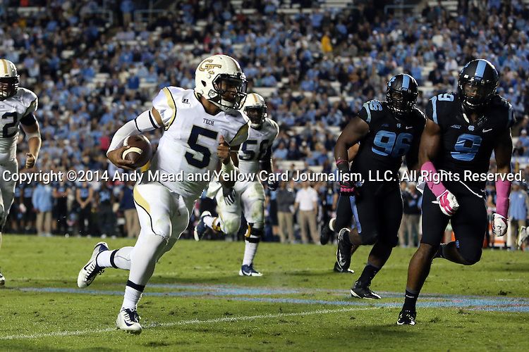 18 October 2014: Georgia Tech's Justin Thomas (5) is chased by UNC's Travis Hughes (9) and Ethan Farmer (96). The University of North Carolina Tar Heels hosted the Georgia Tech Yellow Jackets at Kenan Memorial Stadium in Chapel Hill, North Carolina in a 2014 NCAA Division I College Football game. UNC won the game 48-43.