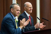 TALLAHASSEE, FLA. 3/7/17-Gov. Rick Scott, right, and House Speaker Richard Corcoran, R-Land O'Lakes, applaud a guest during the State of the State address during opening day of the legislative session at the Capitol in Tallahassee.<br /> <br /> COLIN HACKLEY PHOTO