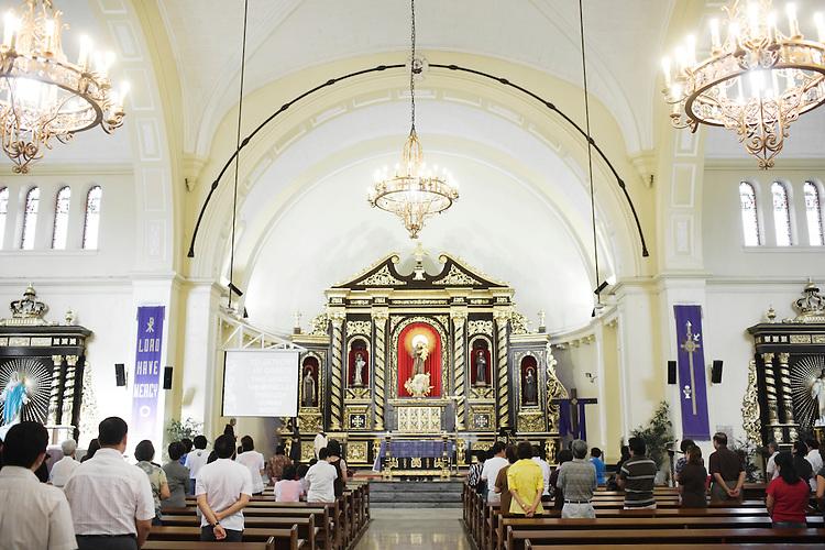 Parishioners worship in San Antonio Catholic Church in Forbes Park, Manila, Philippines.