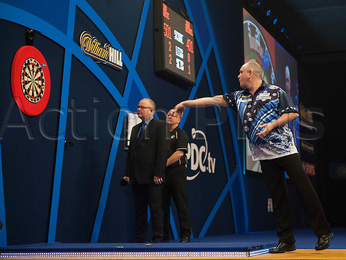 21.12.2014.  London, England.  William Hill PDC World Darts Championship.  Ian White (15) [ENG] in action during his game with qualifier John Michael [GRE].