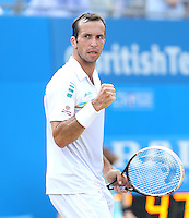 Radek Stepanek (CZE) celebrates during his match versus Kevin Anderson (RSA) - Aegon Tennis Championships, Quarter Final at Queens Club, London - 13/06/14 - MANDATORY CREDIT: Rob Newell - Self billing applies where appropriate - 07808 022 631 - robnew1168@aol.com - NO UNPAID USE - BACS details for payment: Rob Newell A/C 11891604 Sort Code 16-60-51