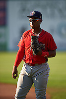 Williamsport Crosscutters first baseman Luis Encarnacion (30) warms up before a game against the Auburn Doubledays on June 25, 2016 at Falcon Park in Auburn, New York.  Auburn defeated Williamsport 5-4.  (Mike Janes/Four Seam Images)